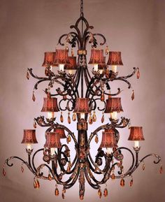 Agatha O | Eighteen #light #chandelier of iron in bronzed sienna finish. Features hand-made floriated shades and amber crystals.  Height: 65″ Width: 55″ Shade: 4 x 5.5 x 5 Bulb(s)   http://houseofdesign.net.au/stylish/traditional-style-designer-crystal-chandelier-young-princes-exotic-dream-house/#