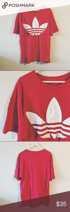 VINTAGE  Red Official ADIDAS t-shirt VINTAGE • Red Official ADIDAS logo t-shirt  • made of softer cotton, but of stretch aa • meat perfect condition; no rips, tears, stains, fading or cracking • size mens x-large but runs big   --- #vintage #vtg #adidas #prelovedfashion #thriftstorefind Vintage Shirts Tees - Short Sleeve