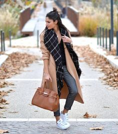 A Black Shirt, Tailored Pants, and Sneakers, Topped Off With a Camel Coat