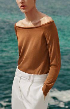 Hermès - Vestiaire d'été 2015. Boat neck pullover in terracotta brown silk knit, men's trousers in milk white linen and viscose.