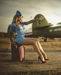 Who doesn't enjoy the sight of a pin-up girl in an air stewardess uniform?!