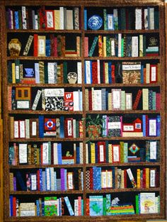This is a real-life-size bookshelf-quilt of Wisconsin writers. l via @JackieMitchard on twitter