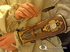 Steampunk Bracer by SqLeatherwork.deviantart.com on @deviantART    Would be evencooler if it was a dagger and not a quill it is hiding...