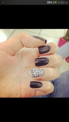 Black matte nails with silver glitter accent nail