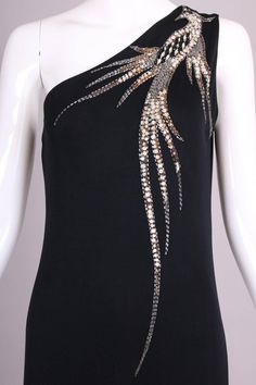 Bob Mackie black silk jersey single-shoulder evening gown with beaded. Bob Mackie black silk jersey single-shoulder evening gown with beaded and sequined firebird design. Bead Embroidery Patterns, Embroidery On Clothes, Couture Embroidery, Embroidery Suits, Embroidery Fashion, Embroidery Jewelry, Hand Embroidery Designs, Beaded Embroidery, Bob Mackie