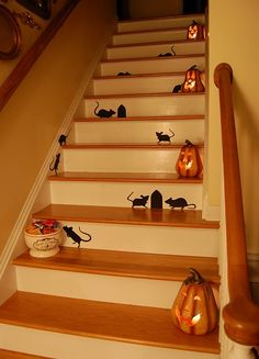 Rat silhouette's on the stairs for halloween. She uses Martha Stewart ones, but I found them at Dollar Tree.... and I am guessing mine were cheaper!