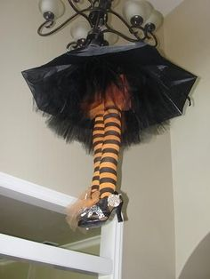 Halloween Chandelier made from stockings, tulle, umbrella, and black shoes.