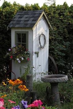 A tiny garden tool shed.