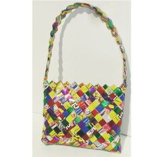 These handbags are made from recycled candy wrappers, food packages, magazines, and other recycled materials. Each bag is handmade with lo. Candy Wrappers, Candy Bags, Recycled Materials, Leather Working, Fabric Crafts, Eco Friendly, Recycling, Artisan, Shoulder Bag