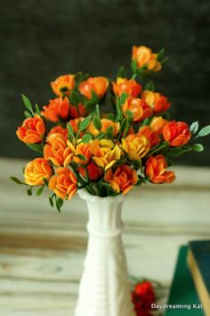 Mid Century Retro Plastic Flowers 10 Orange Rose Stems Vintage Kitsch Plastic Baby Roses crafting Flower Kitschy Artificial Flower Stems by DaydreamingKat on Etsy https://www.etsy.com/listing/511783208/mid-century-retro-plastic-flowers-10