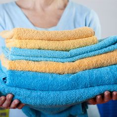 Woman-holding-folded-towels_web