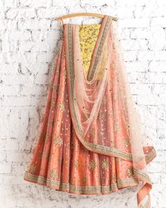 Lehengas by SwatiManish : Flourescent pink orange lehenga with peach dupatta