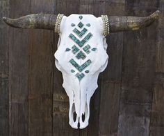 NAVAJO SKIES SKULL >> Real Turquoise stones are cut and laid in a Navajo pattern  >> Layered Ethiopian Heishi beads surround arrow.   >> Ethiopian Heishi detail around the horns  >> >> 5% of all Child of Wild Cow Skull proceeds are donated to art programs in local schools all over Southern California