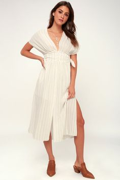 Peruse the farmers market in the ASTR the Label Sierra White and Taupe Striped Midi Dress! Striped woven midi dress with button front and tying side detail.