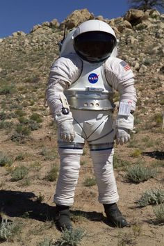 A NASA employeeequipped with a Mark-III suit takes a stroll in Arizona's high desert.