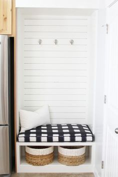 Foyer + Entry Decorating Ideas. Mud room with buffalo plaid pattern on the cushion
