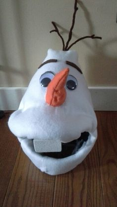 Olaf from Frozen costume diy. Fleece over plastic hat and batting. Do you want to build a snowman?