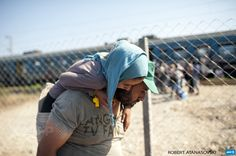MACEDONIA, GEVGELIJA : Migrants walk towards a train heading to Serbia  at the new transit center for migrants on the border between Greece and  Macedonia near the town of Gevgelija, on September 5, 2015. Some 5,600  people crossed into Macedonia from Greece on September 3, a jump that  highlights the ever-rising numbers of migrants moving through Europe,  the UN said on September 4. More than 230,000 refugees and migrants have  arrived in Greece by sea this year, a huge rise from 17,500 in…