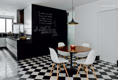 Casa Marques in Brazil with a Beat light from Tom Dixon over the dining table