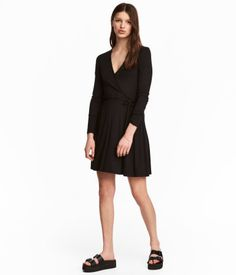 Black. Long-sleeved V-neck dress in soft viscose jersey. Wrapover front section and a decorative tie at side.