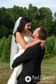 Lauryn and Justin embrace during a formal photo at their July 2016 wedding reception at the Overlook at Geer Tree Farm in Griswold, Connecticut. To see more photos from Justin and Lauryn's wedding, please visit http:// www.tinyurl.com/JustinAndLauryn (Copyright 2016: Paul J. Spetrini Photography)