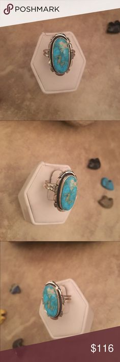 Navajo Kingman Turquoise & Sterling Ring Size 9 This is a wonderful handmade kingman turquoise and Sterling silver ring size 9. The stone is right at 1 inch long and just over 1/2 of an inch wide. This ring is stamped sterling and signed by the artist Larry Yazzie.  