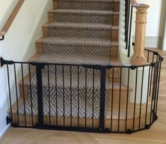 Custom baby and child safety gate installation for stairway in Austin. Baby proofing for stairs, cabinets, drawers, furniture, bathroom electrical and