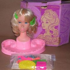 """Barbie Styling head.  I had this exact one.  It came in an octagonal shaped box, and I remember my grandma came to my house on my birthday, and she'd wrapped it up, but I knew just by the shape what it was, and I was screaming, """"You got it for me!  Just what I wanted!""""  before I'd even opened it!  Good times.  I miss my grandma.  She was the best."""