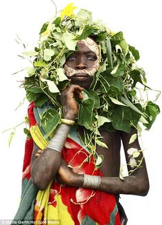 Children often wear face paint made from herbs and plants mixed with white clay...