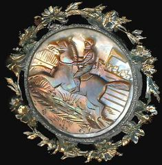 Large Late 19th Century. Carved Mother of Pearl Equestrian Steeplechase in 2 Colors Button. Metal.Frame