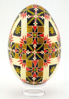 Ukrainian goose Pysanka with triangle, sieve and cross motifs. Triangles are the sign of the Trinity, a cross symbolizes Christianity, and sieves separate good from evil.