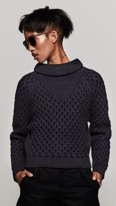Carven Crisscross Pullover Sweater in Marine features a navy cross woven turtleneck; find Carven at TheDreslyn.com