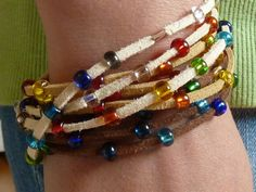 This colorful Gypsy Wrap Bracelet is so easy to make, and it looks amazing! Colorful beads strung onto suede cord creates a multistrand wrap bracelet for when you're feeling fun and playful.