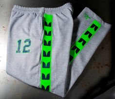 Seattle Seahawks Sweatpants - 2 color neon green and navy stripes on sweats, sweat pants is Similar to seattle Seahawks jerseys Seahawks Fans, Seattle Seahawks, Team Wear, 12th Man, Navy Pants, Hooded Sweater, Navy Stripes, 2 Colours, Neon Green
