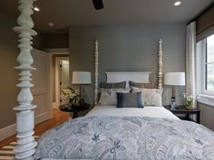Turned wood bedposts stand like sculpture. The crisp white finish provides a nice foil for taupe colored walls.