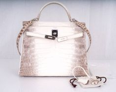 WOWZA! HERMES KELLY BAG 32cm HIMALAYAN WHITE CROCODILE TREAT YOURSELF!! | From a collection of rare vintage handbags and purses at https://www.1stdibs.com/fashion/accessories/handbags-purses/