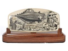 """Nautilus Treasure Trove"" Black and white scrimshaw on ancient mammoth ivory by Jim Pauls. Captain Nemo's Nautilus has come upon the remains of a ship laden with gold from the new world. Pauls' parallel line work is unsurpassed in this one. Also, check out the detail in the Nautilus itself. I really like the rivets in the hull. The complex suits worn by the two divers are incredible. Size: 5 1/2""L x 2""D x 3""H  Price: $2,450.00 -- on ScrimshawGallery.com #scrimshaw"