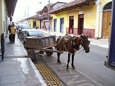 Street in Granada, Nicaragua – The cost to buy a car in Nicaragua is at least 20 to 30% more in Nicaragua than in the US for domestic models. The main reason it costs more, is because of taxes.  The Chinese, however, are starting to come in much cheaper.