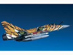 Highlight of the tigers was this French Mirage with serial Hosting this year's Tiger Meet, could obviously not show up with just a modest tiger painting on a tail, so they decided to apply this stunning scheme on one of their aircraft. Military Jets, Military Weapons, Military Aircraft, Aircraft Parts, Fighter Aircraft, Fighter Jets, Airplane Painting, Photo Avion, Camouflage