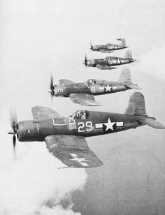 "F4U Corsairs Flying in Formation. U.S. Navy VF-17 Fighting 17 ""The Jolly Rogers"""
