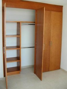 Closets minimalista con puertas corredizas lqe for Closets de madera modernos economicos