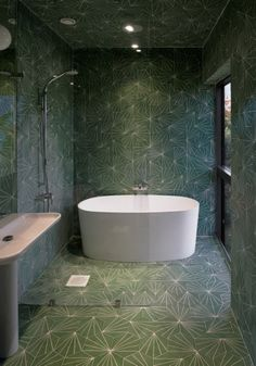 Funky #tiles imitating wallpaper. Fab #cool small #bathroom.Don't be afraid to use dark colours in small space.