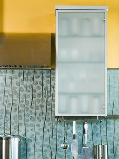 Glass-Front Alternative  Love the look of glass-front cabinets, but aren?t so sure you want your cabinet?s contents completely visible? Try opaque or frosted glass instead, which gives off the same light look as transparent glass, but still conceals the interior.