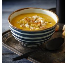 Roasted Havest Soup with Walnut Pesto. I would substitute the walnut pesto but otherwise sounds delish!