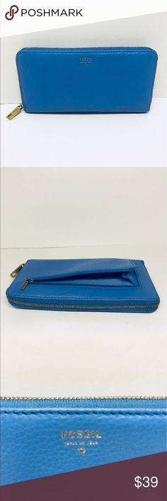 FOSSIL SYDNEY Zip Clutch WALLET Blue leather Fossil Sydney clutch wallet. Very pretty blue. Excellent used condition . Does not have strap. Fossil Bags Wallets