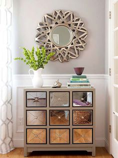 Fresh Face.. Cover the front of a cabinet drawers with mirror paint for a neat effect. Add metallic knobs.!