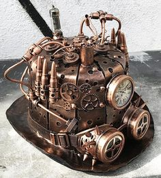 STEAMPUNK TOP HAT - Copper Steampunk Hat with Sheet Metal, Gears, Rivets, Tubes, Bullet Cartridges, Spikes, Gauge, and Goggles. A work of art and craftsmanship. One size fits most (approx 23.5) Dont leave home without it! The goggles 2 inch (50mm) lenses are interchangeable. Available