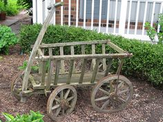 Vintage goat cart - love mine, even empty makes me smile - but do love it in the spring with flower pots in it Wooden Cart, Wooden Wagon, Garden Gates, Garden Art, Flower Cart, Flower Pots, Wooden Wheelbarrow, Wagon Wheels, Old Wagons