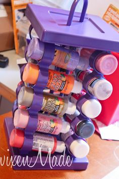 Spice Rack to hold paint, glitter, and other craft supplies.  Genius!... I'll look for one at the thrift store!
