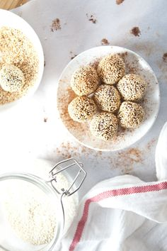 Cinnamon Tahini Truffles! These velvety, slightly chewy truffles are delicious have an unusual flavor; dark chocolate with hints of tahini and cinnamon, finished with a sesame seed crunch. (Vegan, Gluten-Free, Paleo)  Please repin! http://ourfourforks.com/cinnamon-tahini-truffles/